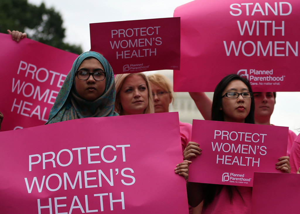 WASHINGTON, DC - JULY 11: Women hold up signs during a women's pro-choice rally on Capitol Hill, July 11, 2013 in Washington, DC. The rally was hosted by Planned Parenthood Federation of America to urge Congress against passing any legislation to limit access to safe and legal abortion.  (Photo by Mark Wilson/Getty Images)